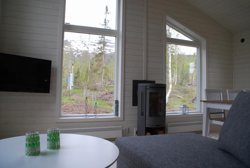 Creativstugan vardagsrum med kamin